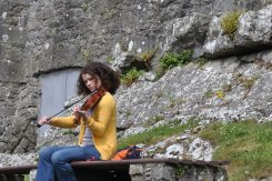 Fiddle player at the Rock of Cashel